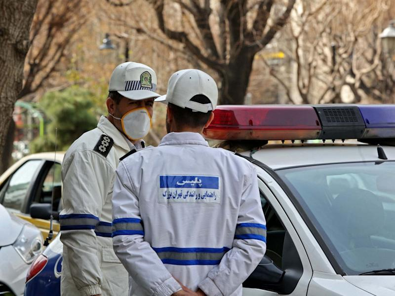 Emergency first responders wear protective masks stand in Tehran: AFP via Getty Images