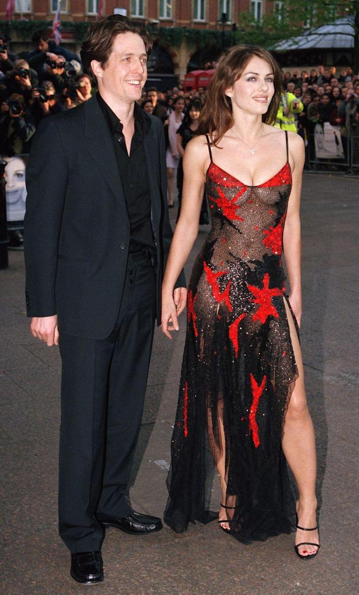 <p>At another one of Hugh's premieres, this time for <em>Notting Hill. </em>Now <em>this</em> is what you call a statement dress, people.</p>