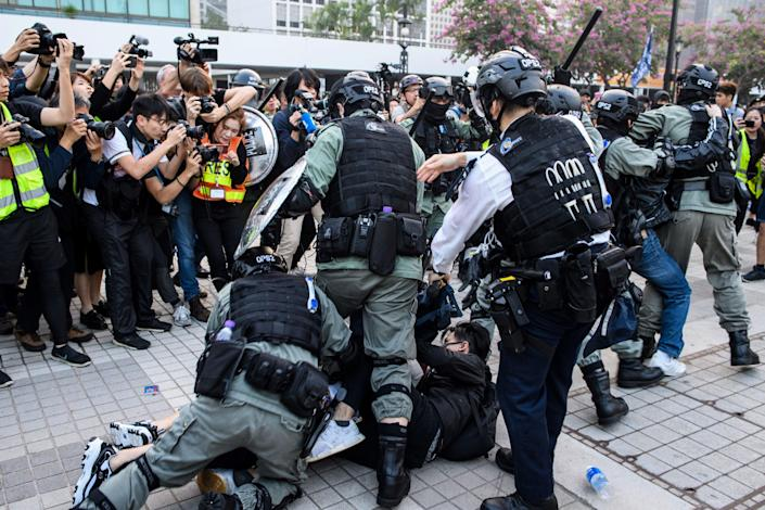<p>Police detain a man during a rally in Hong Kong on 22 December 2019 to show support for the Uighur minority in China.</p> (Getty Images)