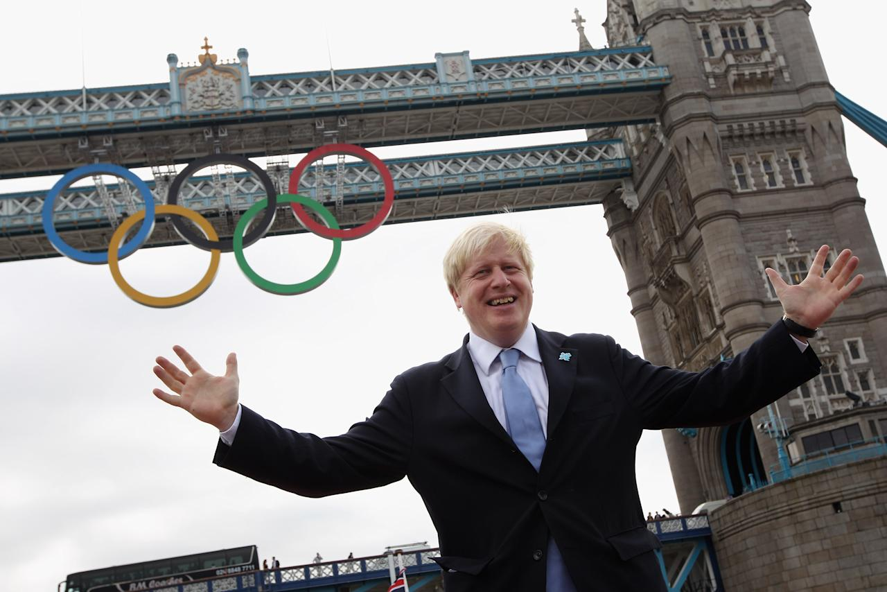 Mayor of London Boris Johnson cheers as a giant set of Olympic rings are displayed from Tower Bridge on June 27, 2012 in London, England. The rings weigh over three tonnes and measure over 25 metres wide by 11.5 metres tall; they will be illuminated in a light-show every evening during the Games.  (Photo by Oli Scarff/Getty Images)