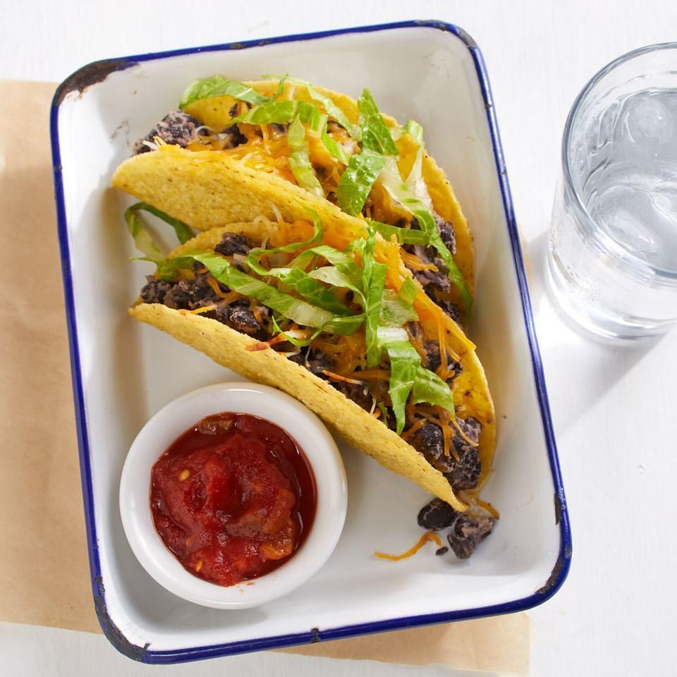 <p>Mixing mashed canned beans with whole beans and seasonings makes an incredibly simple taco filling from your pantry. Top these speedy 5-ingredient tacos with lettuce, tomato and salsa or any of your favorite taco toppings.</p>