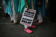 FILE - In this Sunday, April 15, 2018, file photo, Indian protestors display placards during a protest against two recently reported rape cases as they gather near the Parliament in New Delhi, India. The gang rape and death of a woman from the lowest rung of India's caste system sparked an outrage across the country on Wednesday, Sept. 30, 2020, with several politicians and activists demanding justice and protesters rallying on the streets. The 19-year-old woman's death is the latest gruesome case of sexual violence against women to rile India, where reports of rape are hauntingly familiar. (AP Photo/Oinam Anand, File)