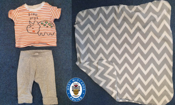 The baby was found in a stripey t-shirt, grey leggings and a grey blanket. (West Midlands Police)