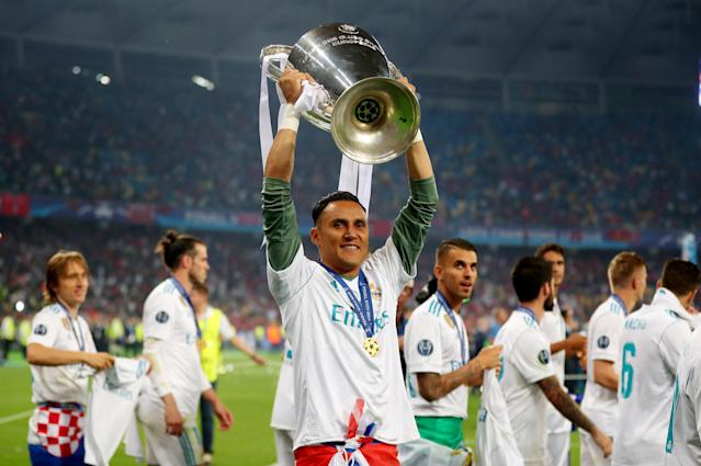 Soccer Football - Champions League Final - Real Madrid v Liverpool - NSC Olympic Stadium, Kiev, Ukraine - May 26, 2018 Real Madrid's Keylor Navas celebrates winning the Champions League with the trophy REUTERS/Hannah McKay
