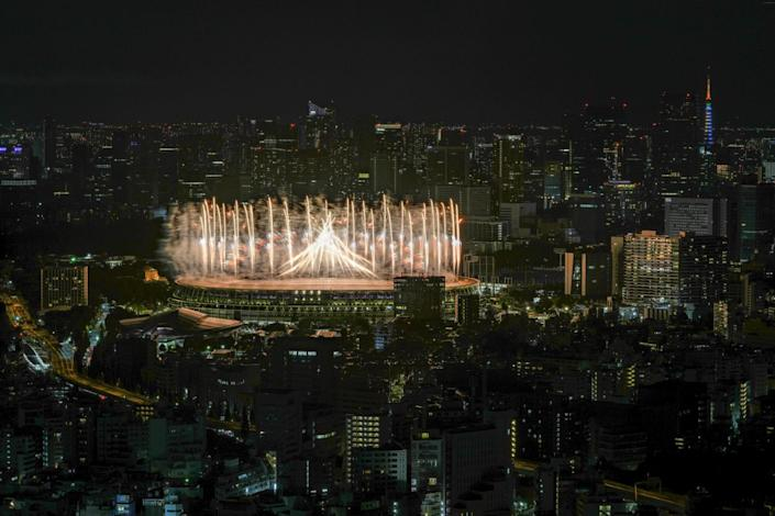 Fireworks illuminate over National Stadium during the opening ceremony of the Tokyo Olympics.