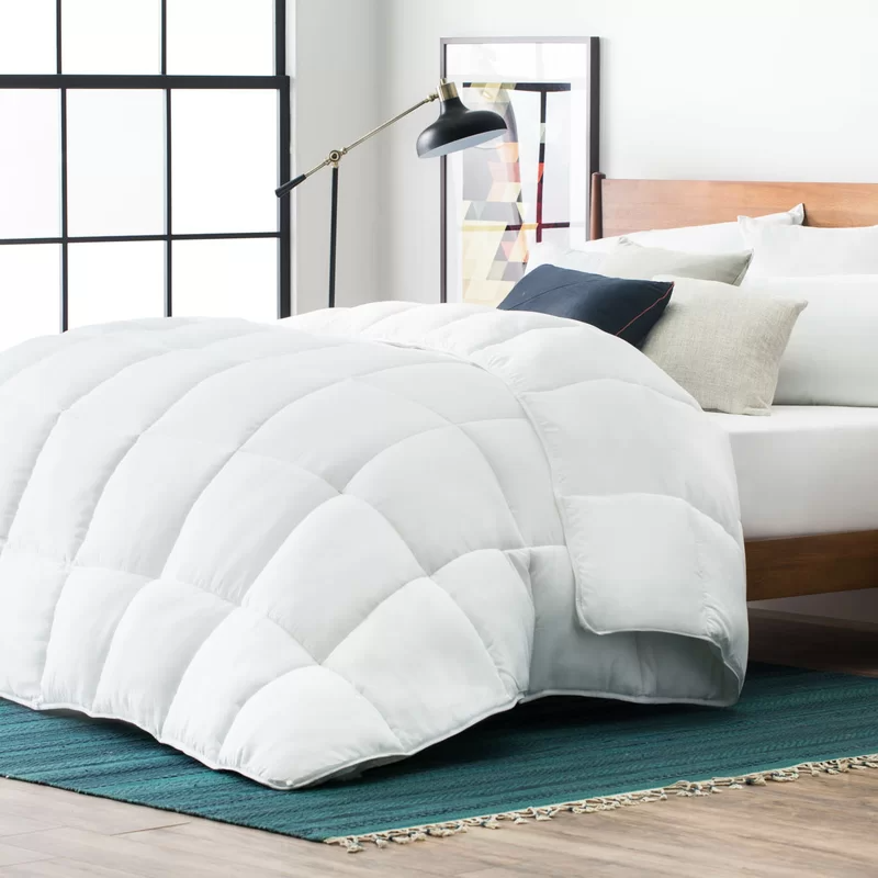 "<h2>Joss & Main All Season Single Alternative Down Comforter </h2><br>This down alternative comforter is made for all-season use and those who suffer from allergies. Its hypoallergenic microfiber fill keeps you cozy in the chilly winter months but is still breathable for suitable use in the warmer months. <br><br><strong>The Hype:</strong> 4.7 out of 5 stars and 2,225 reviews on <a href=""https://www.jossandmain.com/bedding-bath/pdp/all-season-single-down-alternative-comforter-anew2685.html"" rel=""nofollow noopener"" target=""_blank"" data-ylk=""slk:Joss & Main"" class=""link rapid-noclick-resp"">Joss & Main</a><br><br><strong>Comfort Seekers Say:</strong> ""Perfect Duvet insert! It was the exact size I needed for the duvet I purchased. But most importantly I was research down alternative comforters, quality, material, fabric, weight, if it would be too warm, etc. This duvet insert got rave reviews! it's the perfect weight and it has corner loops to secure duvet cover (very important!) and it doesn't make you hot! PLUS it's machine washable. We live in FL and keep our house at 68 degrees and it's perfect!"" –– <em>Barbara, Joss & Main Reviewer </em><br><br><strong>Joss & Main</strong> All Season Single Down Alternative Comforter, $, available at <a href=""https://go.skimresources.com/?id=30283X879131&url=https%3A%2F%2Fwww.jossandmain.com%2Fbedding-bath%2Fpdp%2Fall-season-single-down-alternative-comforter-anew2685.html"" rel=""nofollow noopener"" target=""_blank"" data-ylk=""slk:Joss & Main"" class=""link rapid-noclick-resp"">Joss & Main</a>"
