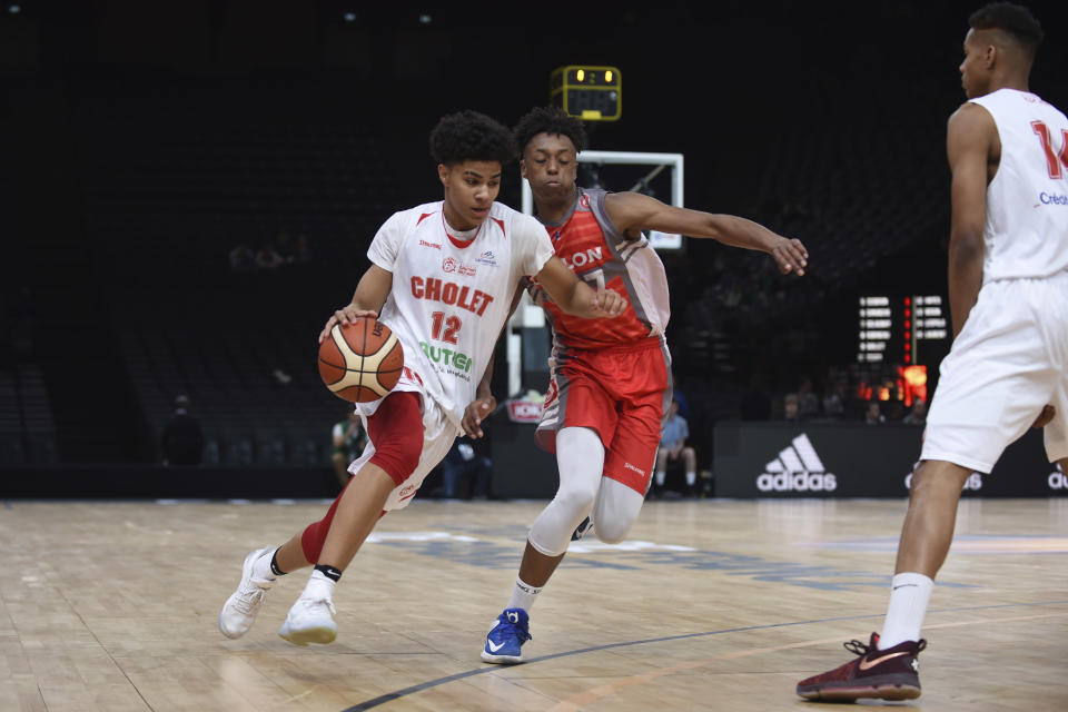 Cholet's Killian Hayes, left, drives against an unidentified Chalon-sur-Saone player during the French Cup under-17 final in Paris on April 22, 2017. Hayes is considered a top-10 prospect and one of the top point guards in the NBA draft on Nov. 18. (AP Photo)