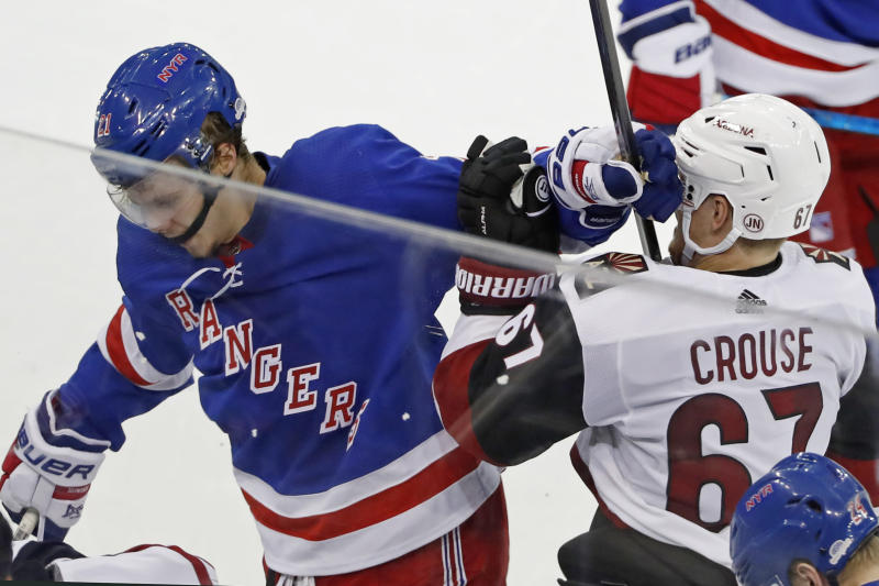 New York Rangers center Brett Howden (21) lands a punch to the head of Arizona Coyotes left wing Lawson Crouse (67) during the third period of an NHL hockey game Tuesday, Oct. 22, 2019, in New York. The Coyotes won 3-2 in overtime. (AP Photo/Kathy Willens)