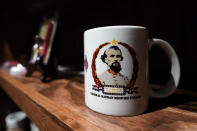 A mug decorated with a portrait of Confederate Gen. Nathan Bedford Forrest is displayed in the souvenir shop at the National Confederate Museum June 6, 2021, in Columbia, Tenn. With the approval of relatives, the remains of Forrest will be moved from Memphis, Tenn., to the museum. (AP Photo/Mark Humphrey)