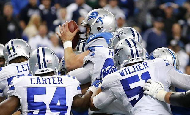Detroit Lions quarterback Matthew Stafford (9) scores on a 1-yard touchdown run against the Dallas Cowboys in the fourth quarter of an NFL football game in Detroit, Sunday, Oct. 27, 2013. (AP Photo/Rick Osentoski)