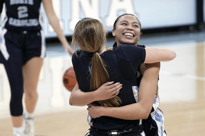North Carolina guard Stephanie Watts, right, hugs guard Alyssa Ustby following an NCAA college basketball game against North Carolina State in Chapel Hill, N.C., Sunday, Feb. 7, 2021. (AP Photo/Gerry Broome)