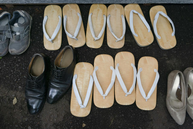 Traditional Japanese footwear called zori are seen next to sneakers and dress shoes during a kendo competition at the Hie Shrine in Tokyo, June 8, 2019. (AP Photo/Jae C. Hong)