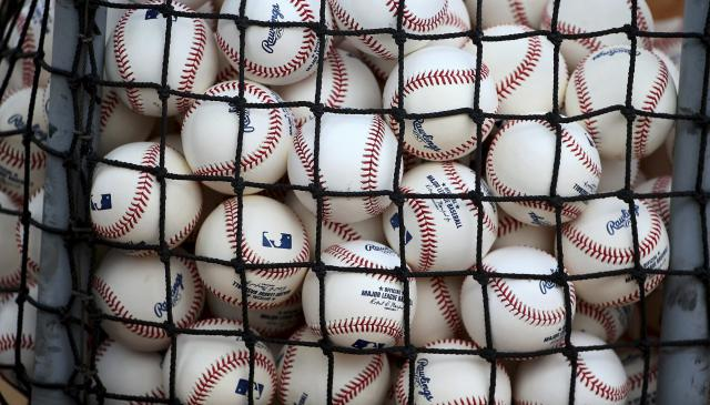 New baseballs await being used during workouts at the Cincinnati Reds spring training baseball facility, Wednesday, Feb. 13, 2019, in Goodyear, Ariz. (AP Photo/Ross D. Franklin)