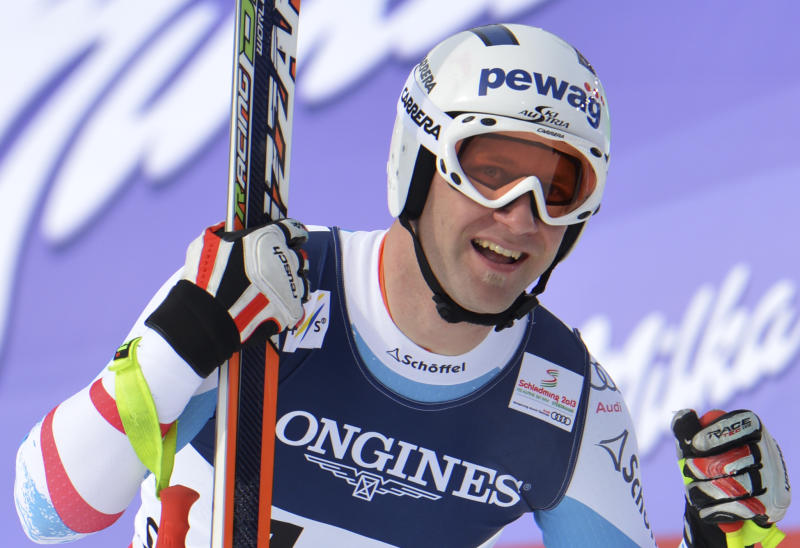 Austria's RomedBaumann smiles after the downhill run of the men's super-combined  at the Alpine skiing world championships in Schladming, Austria, Monday, Feb. 11, 2013. (AP Photo/Kerstin Joensson)