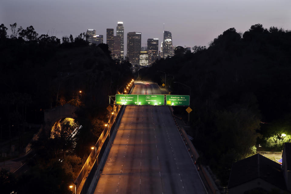 FILE - In this April 2, 2020, file photo, light traffic is seen on the 110 freeway with the city skyline in the background in Los Angeles. California, for decades a symbol of boundless growth and opportunity that attracted people from across the U.S. and abroad, has stagnated. Census data expected later this month will reveal what demographers and observers have long known: That California is now growing at a record slow rate and behind rival political states like Texas and Florida. That could cause the state to lose a U.S. House seat for the first time in its history. (AP Photo/Marcio Jose Sanchez, File)
