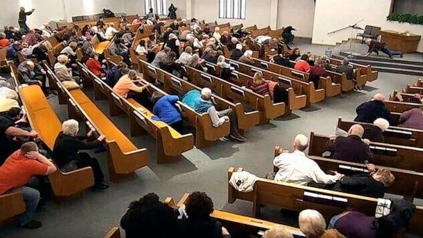 PHOTO: In this still frame from livestreamed video provided by law enforcement, churchgoers take cover after an armed man opened fire during a service at West Freeway Church of Christ, Dec. 29, 2019, in White Settlement, Texas. (West Freeway Church of Christ/Courtesy of Law Enforcement via AP)
