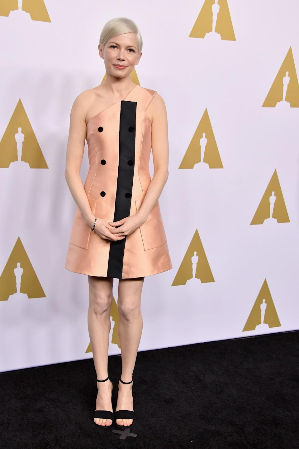<p>Michelle Williams looked as elegant as ever in a custom Louis Vuitton silk dress. Not many of us could pull off this peachy hue, but Michelle with her peroxide pixie crop did it effortlessly. [Photo: Getty] </p>