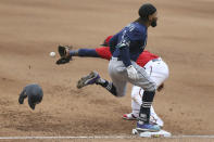 Seattle Mariners' J.P. Crawford (3) best the throw to first base as Minnesota Twins' Miguel Sano (22) reaches for he ball during the eighth inning of a baseball game, Saturday, April 10, 2021, in Minneapolis. Seattle won 4-3 in the 10 innings. (AP Photo/Stacy Bengs)