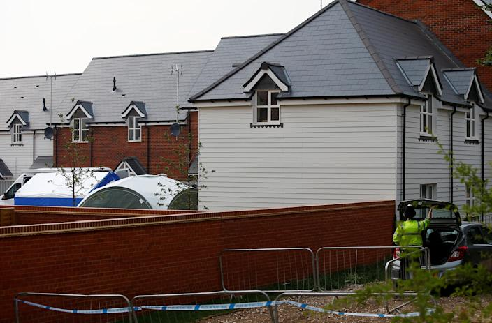 Police forensic tents can be seen to the rear of a housing estate on Muggleton Road, after it was confirmed that two people had been poisoned with the nerve-agent Novichok, in Amesbury, Britain, July 5, 2018. REUTERS/Henry Nicholls
