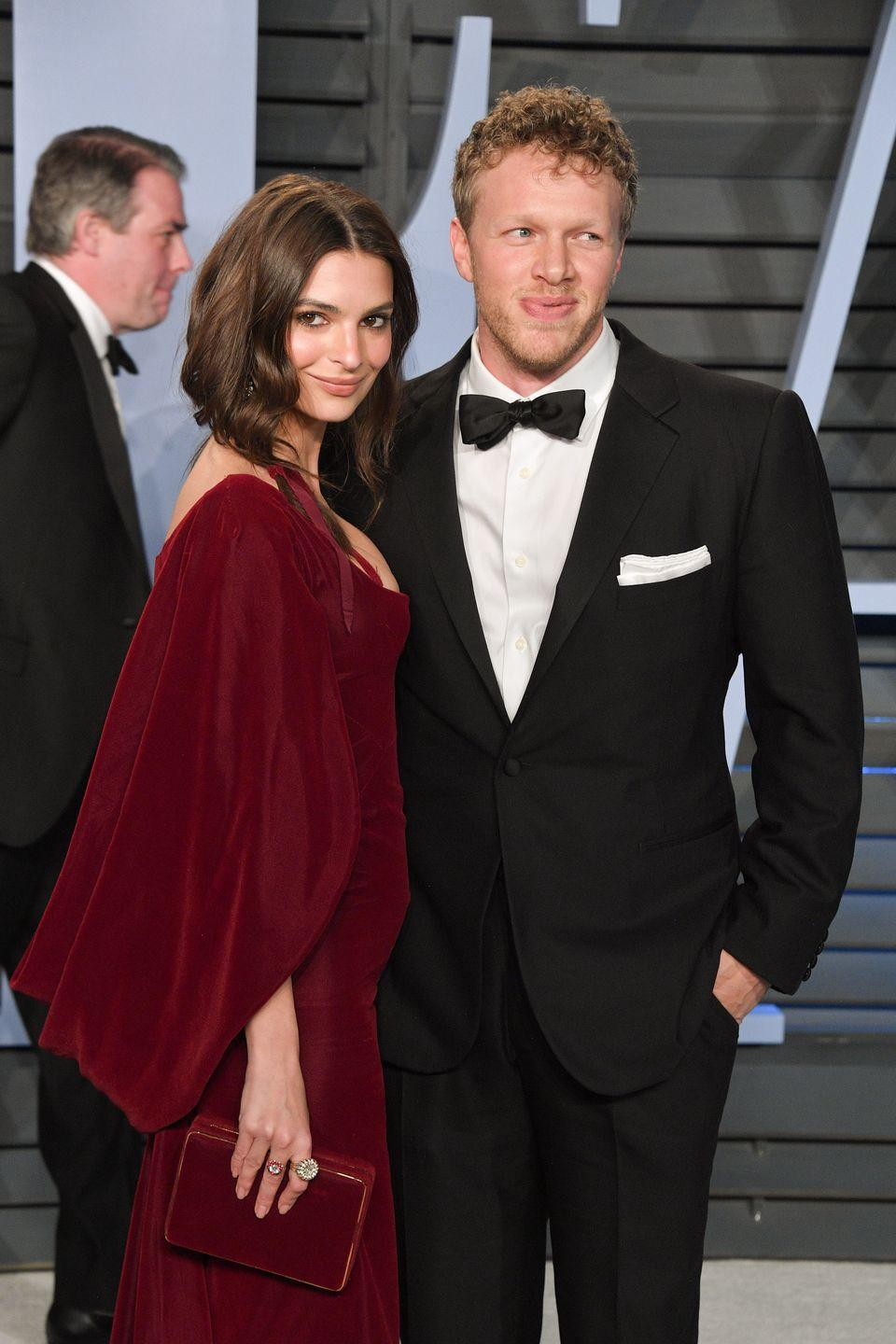 """<p>Emily Ratajkowski kept her wedding simple when she eloped with Sebastian Bear at the courthouse in New York City, wearing a mustard yellow pantsuit and a black veiled hat. Emily <a href=""""https://www.instagram.com/p/Bfje4PBFMMI/?"""" rel=""""nofollow noopener"""" target=""""_blank"""" data-ylk=""""slk:shared the news on Instagram"""" class=""""link rapid-noclick-resp"""">shared the news on Instagram</a>, with the <a href=""""https://www.harpersbazaar.com/celebrity/latest/a18699792/emily-ratajkowski-married/"""" rel=""""nofollow noopener"""" target=""""_blank"""" data-ylk=""""slk:caption"""" class=""""link rapid-noclick-resp"""">caption</a>, """"Sooo, I have a surprise, I got married today.""""</p>"""