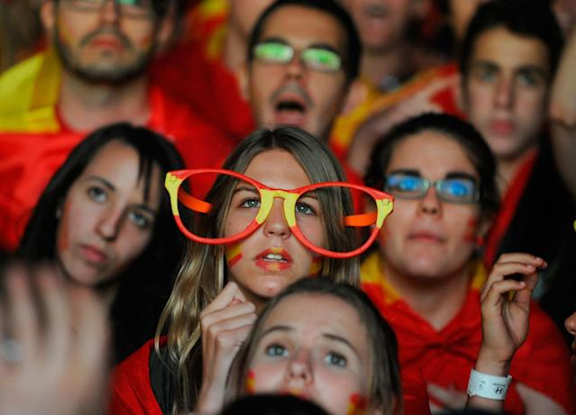 MADRID, SPAIN - JULY 01: Spain fans watch the UEFA EURO 2012 final match between Spain and Italy on a giant outdoor screen on Paseo de la Castellana on July 1, 2012 in Madrid, Spain. (Photo by Denis Doyle/Getty Images)