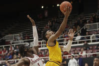 Arizona State guard Remy Martin, right, shoots next to Stanford guard Daejon Davis during the second half of an NCAA college basketball game in Stanford, Calif., Thursday, Feb. 13, 2020. (AP Photo/Jeff Chiu)