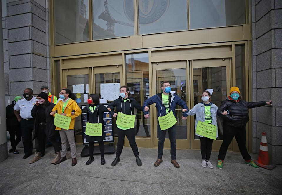 BOSTON, MA - OCTOBER 29: Demonstrators block the entrance to the courthouse during a rally at Boston Housing Court outside the Edward W. Brooke Courthouse in Boston on Oct. 29, 2020. Protesters called for the passing of bill H.5018, an act to guarantee hosing stability during the Covid-19 pandemic. (Photo by David L. Ryan/The Boston Globe via Getty Images)