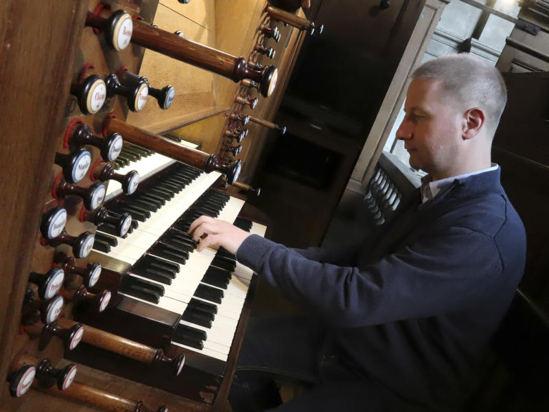 Johann Vexo, the organist who was playing at evening mass inside Notre Dame when flames began licking at the iconic cathedral's roof, pllays the pipe organ at Notre Dame de Nancy cathedral, eastern France, Wednesday, April 17, 2019. Vexo , who was playing at evening mass inside Notre Dame when flames began licking at the iconic cathedral's roof says people didn't immediately react when the fire alarm rang as a priest was reading from the Bible. (AP Photo/Oleg Cetinic)