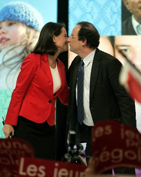 "FILE - Socialist French presidential candidate Segolene Royal, left, kisses her partner Secretary-General of the Socialist Party Francois Hollande during a meeting in Limoges, central France, in this file photo dated Thursday March 29, 2007. According to reports on Friday July 13, 2012, French President Fancois Hollande is widely expected to break his silence about ""tweetgate"", the alleged family feud involving the mother of his children Segolene Royal, his eldest son Thomas and his current companion Valerie Trierweiler, that has riveted the media and the Internet, during a television interview to be broadcast Saturday July 14, 2012. (AP Photo/Michel Euler, file)"
