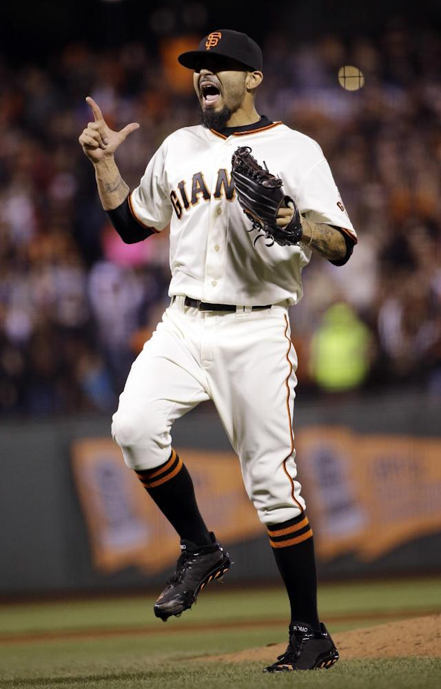San Francisco Giants reliever Sergio Romo celebrates as he records the last out of the game against the Los Angeles Dodgers during the ninth inning of a baseball game on Wednesday, April 16, 2014, in San Francisco. San Francisco won 2-1. (AP Photo/Marcio Jose Sanchez)