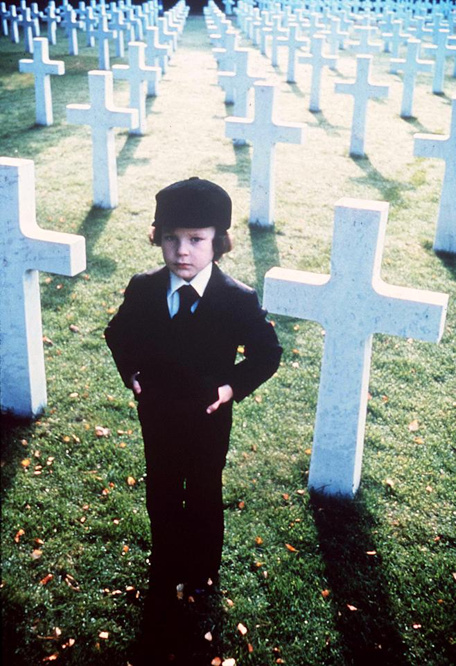 """13. Damien Thorn, <a href=""""http://movies.yahoo.com/movie/1800102800/info"""">The Omen</a>   What do you get when Satan impregnates a jackal? The Antichrist, of course ... in the form of a five-year-old named Damien, whose piercing black eyes and blacker heart prove that not all little boys are made of snips and snails and puppy dog tails. Some are just made of pure evil."""