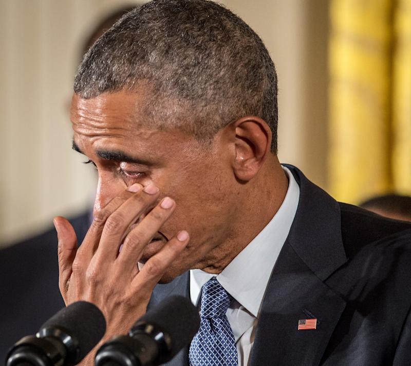<strong>Barack Obama wipes away tears as he talks about needless shootings at Sandy Hook Elementary school during a press briefing in January, 2015</strong> (Ken Cedeno via Getty Images)