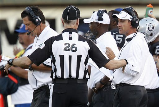 Oakland Raiders head coach Dennis Allen, right, talk with an official during the third quarter of an NFL preseason football game against the Dallas Cowboys in Oakland, Calif., Monday, Aug. 13, 2012. (AP Photo/Tony Avelar)