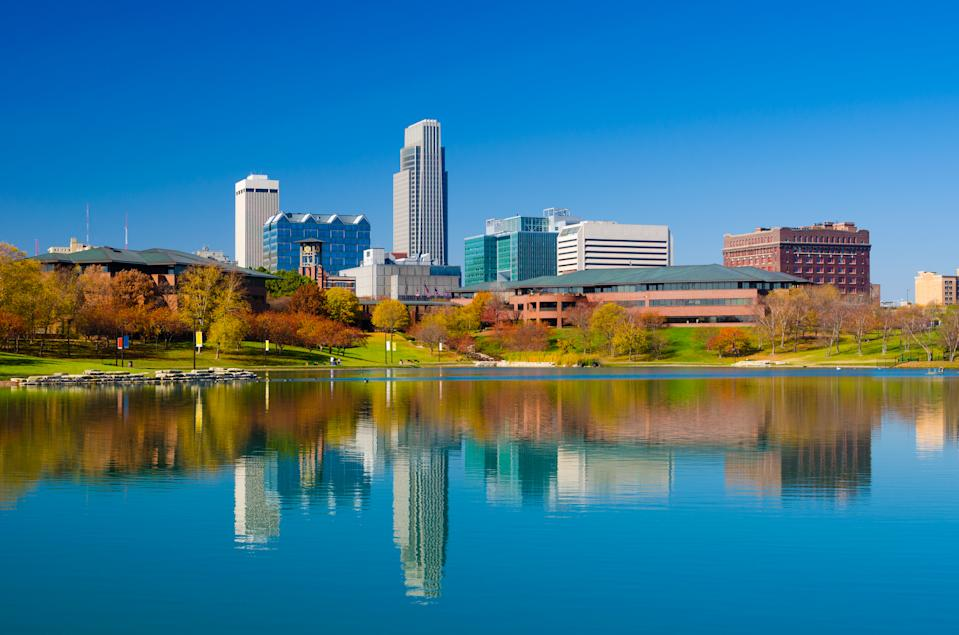 Omaha downtown skyline during Autumn, with a lake at the Heartland of America Park in the foreground
