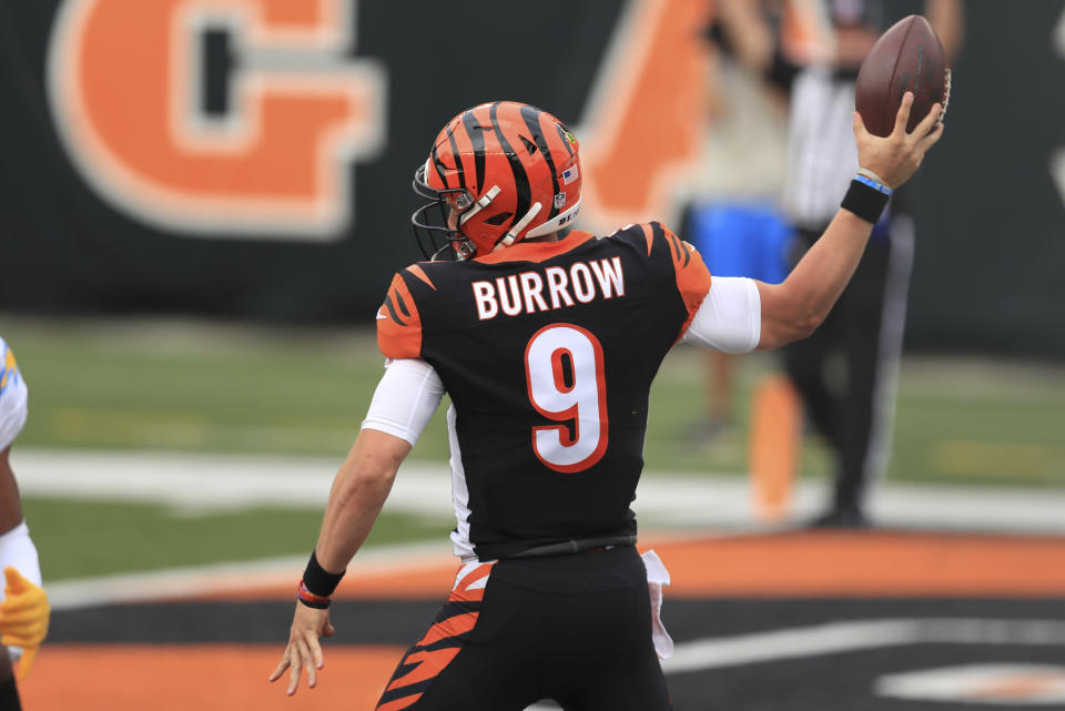 Cincinnati Bengals quarterback Joe Burrow (9) reacts after running for a touchdown during the first half of an NFL football game against the Los Angeles Chargers, Sunday, Sept. 13, 2020, in Cincinnati. (AP Photo/Aaron Doster)