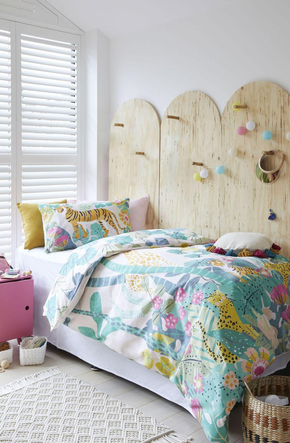 """<p>The beauty of an all-white girls' bedroom scheme is that it's essentially a blank canvas that can be changed up as and when. Bedding and accessories add the colour and pattern and look out for ways to make the space more individual. We love these plywood panels that can be used to hang things off; it's genius and it could be painted too if you want to add more colour.</p><p>Pictured: Equatorial bedding, <a href=""""https://go.redirectingat.com?id=127X1599956&url=https%3A%2F%2Fwww.dunelm.com%2Fproduct%2Fgreen-floral-reversible-100-cotton-duvet-cover-and-pillowcase-set-1000182129&sref=https%3A%2F%2Fwww.housebeautiful.com%2Fuk%2Fdecorate%2Fbedroom%2Fg35589644%2Fgirls-bedroom-ideas%2F"""" rel=""""nofollow noopener"""" target=""""_blank"""" data-ylk=""""slk:Dunelm"""" class=""""link rapid-noclick-resp"""">Dunelm</a></p>"""