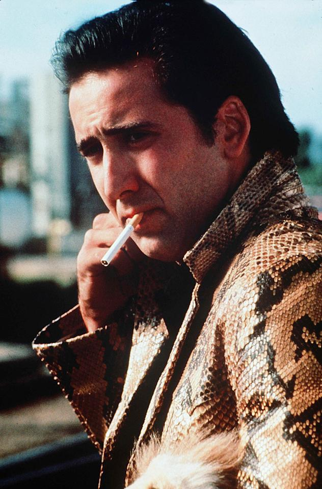 "<a href=""http://movies.yahoo.com/movie/1800143649/info"">WILD AT HEART</a> -- The Graceland Ducktail    Nic channels the King with this slicked-back pompadour. All the more creepy that he later got hitched to Elvis' daughter, Lisa Marie."