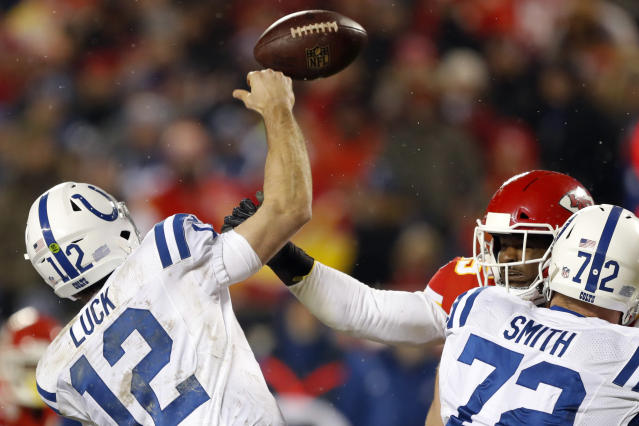 Kansas City Chiefs linebacker Dee Ford, back right, causes Indianapolis Colts quarterback Andrew Luck (12) to fumble the ball for a turnover, during the second half of an NFL divisional football playoff game in Kansas City, Mo., Saturday, Jan. 12, 2019. (AP Photo/Charlie Neibergall)