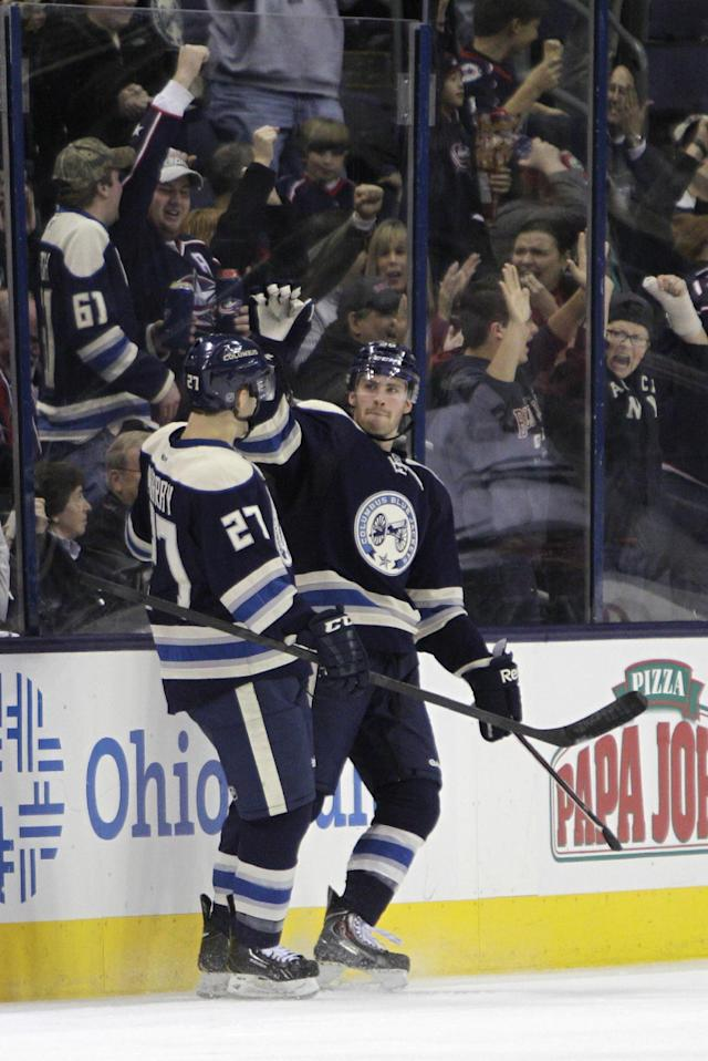 Columbus Blue Jackets' Boone Jenner, right, celebrates his goal against the Minnesota Wild with teammate Ryan Murray during the third period of an NHL hockey game on Friday, Dec. 6, 2013, in Columbus, Ohio. The Blue Jackets won 4-0. (AP Photo/Jay LaPrete)