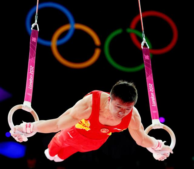 Yibing Chen of China competes in the rings in the Artistic Gymnastics Men's Team final on Day 3 of the London 2012 Olympic Games at North Greenwich Arena on July 30, 2012 in London, England. (Photo by Ronald Martinez/Getty Images)
