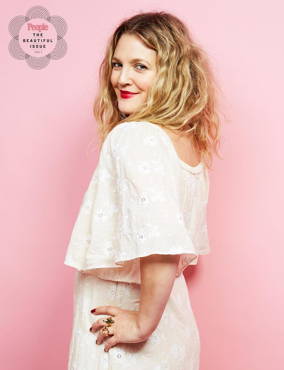 "<p>Already invested in beauty thanks to her Flower Beauty makeup line, the 46-year-old actress has spent the year focused on inner beauty, launching her eponymous talk show and lifting up the celebrities and everyday people she features on the series. </p> <p><a href=""https://people.com/parents/valentines-day-2021-drew-barrymore-rare-photos-daughters-frankie-olive-will-kopelman/"" rel=""nofollow noopener"" target=""_blank"" data-ylk=""slk:On Valentine's Day"" class=""link rapid-noclick-resp"">On Valentine's Day</a>, she sent a message of unity to followers alongside a photo of her young daughters, wishing for everyone to be ""wrapped up in love.""</p>"