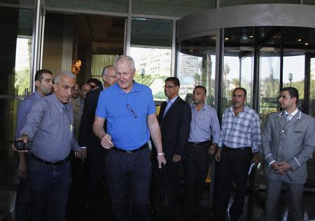 Ake Sellstrom, the head of a U.N. chemical weapons investigation team, leaves a hotel in Damascus