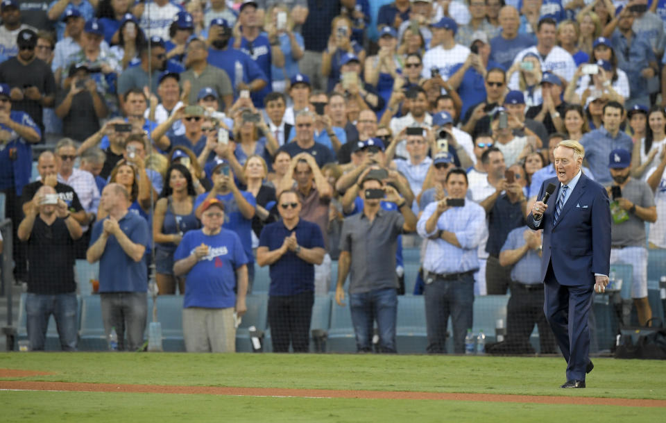<p>Vin Scully helps throw out the ceremonial first pitch before Game 2 of baseball's World Series between the Houston Astros and the Los Angeles Dodgers Wednesday, Oct. 25, 2017, in Los Angeles. (AP Photo/Mark J. Terrill) </p>