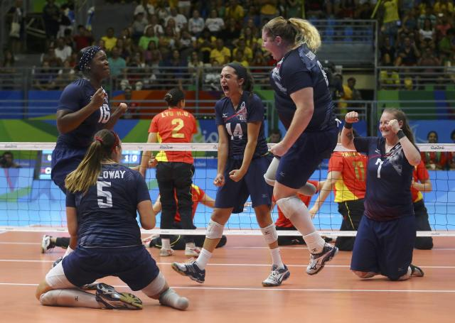 2016 Rio Paralympics - Sitting Volleyball - Final - Women's Gold Medal Match - Riocentro Pavilion 6 - Rio de Janeiro, Brazil, 17/09/2016. Players of team United States celebrate. REUTERS/Pilar Olivares FOR EDITORIAL USE ONLY. NOT FOR SALE FOR MARKETING OR ADVERTISING CAMPAIGNS.