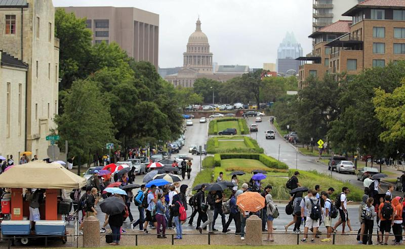 University of Texas students evacuate campus after the university received a bomb threat Friday morning, Sept. 14, 2012 in Austin, Texas. The university received a call about 8:35 a.m. local time from a man claiming to be with al-Qaida who said he had placed bombs all over the 50,000-student Austin campus, according to University of Texas spokeswoman Rhonda Weldon. (AP Photo/Statesman.com, Ricardo B. Brazziell)