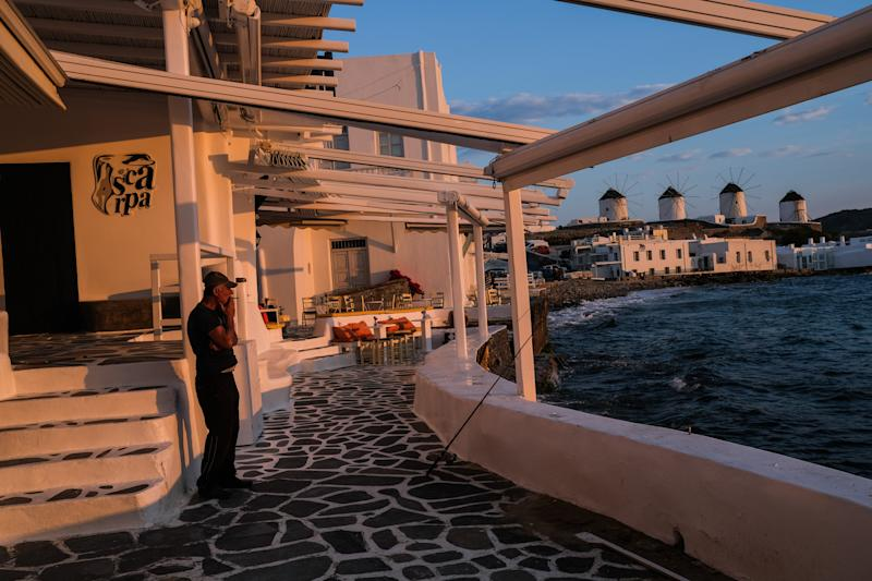 MYKONOS, GREECE - MAY 25: The sunset scene in the Little Venice neighborhood on May 25, 2020 in Mykonos, Greece. After months of being on lockdown due to the coronavirus, Greece will begin to ease travel restrictions on movement between the mainland and the countrys islands. (Photo by Byron Smith/Getty Images)