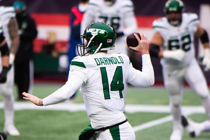 Sam Darnold #14 of the New York Jets makes a pass against the New England Patriots in the first half at Gillette Stadium on January 3, 2021, in Foxborough, Mass. (Kathryn Riley/Getty Images/TNS)