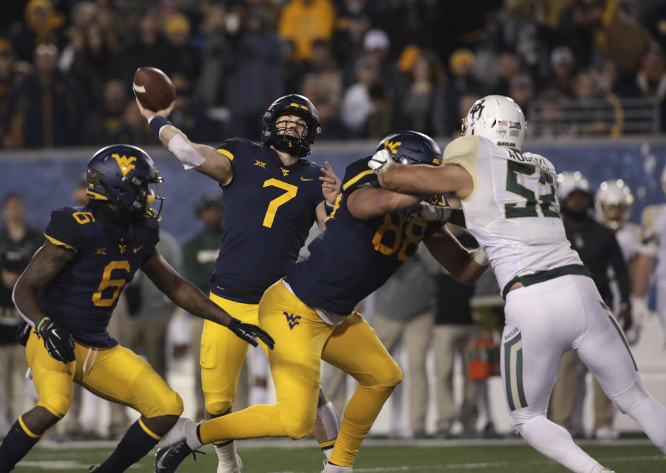 Will Grier (7) and West Virginia can take a huge step closer to the Big 12 title game on Saturday against Texas. (AP)