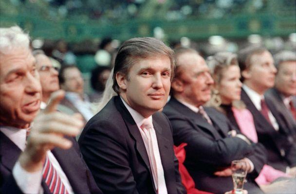 PHOTO: Donald Trump sits near father Fred Trump ringside at Tyson vs Holmes Convention Hall in Atlantic City, N.J., Jan. 22 1988. (Jeffrey Asher/Getty Images, FILE)