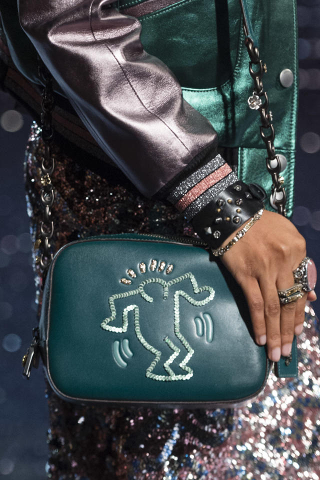 <p><i>Teal leather handbag with Keith Haring emblem from the SS18 Coach collection. (Photo: ImaxTree) </i></p>